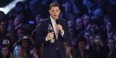Michael Buble accepts an award at the 2010 Junos