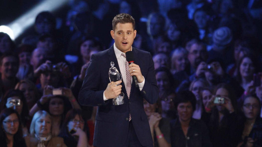 Michael Buble accepts an award at the 2010 Junos