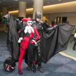 Fans dressed as Harley Quinn and Batman