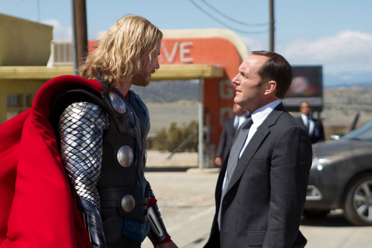 Chris Hemsworth as Thor opposite Clark Gregg as Agent Coulson