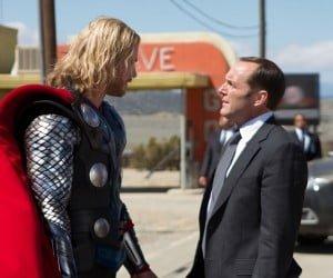Chris Hemsworth as Thor opposite Clark Gregg as Agent Coulson