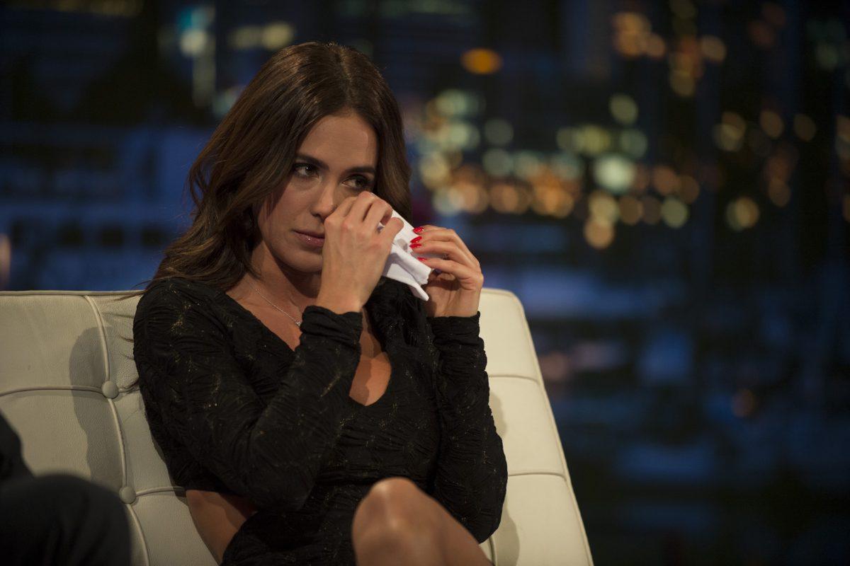 Whitney wipes away a tear