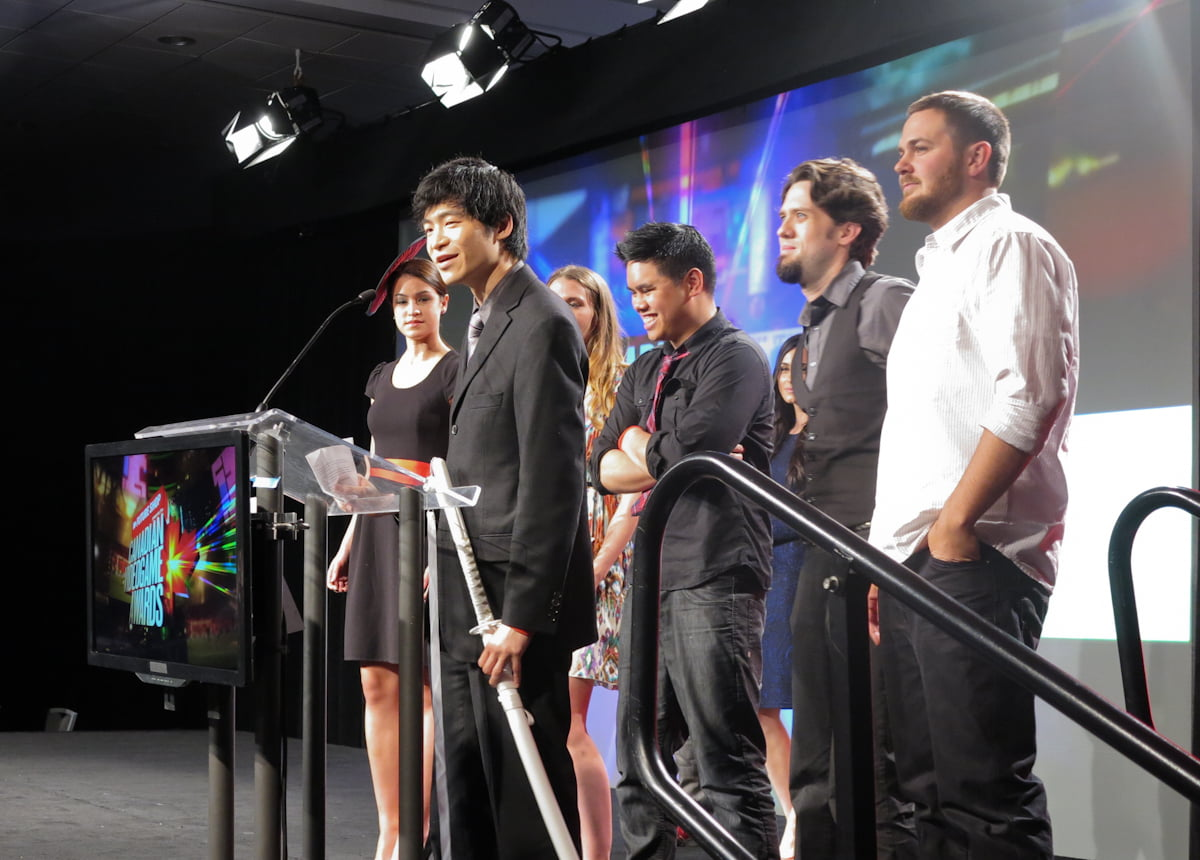Jamie Cheng, owner of Klei Entertainment, accepts the award for best Downloadable Game