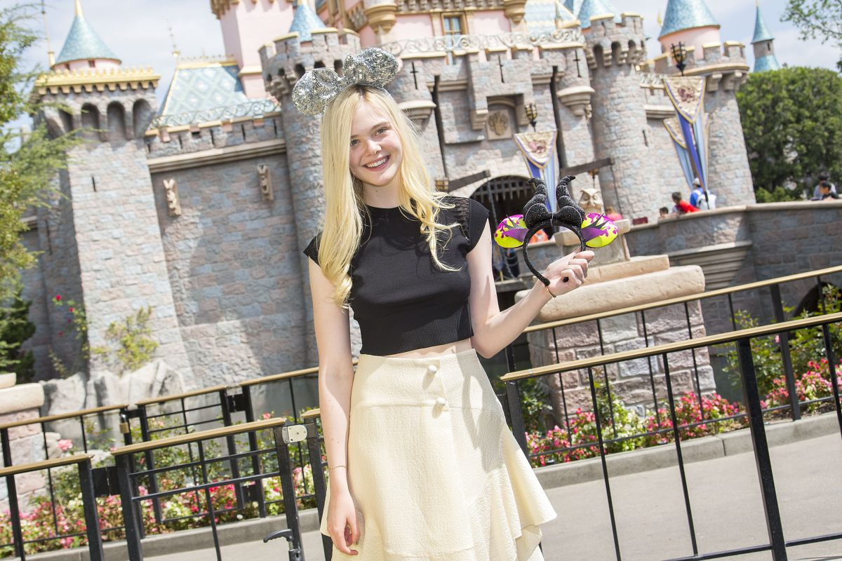 Elle Fanning in front of Sleeping Beauty Castle at Disneyland