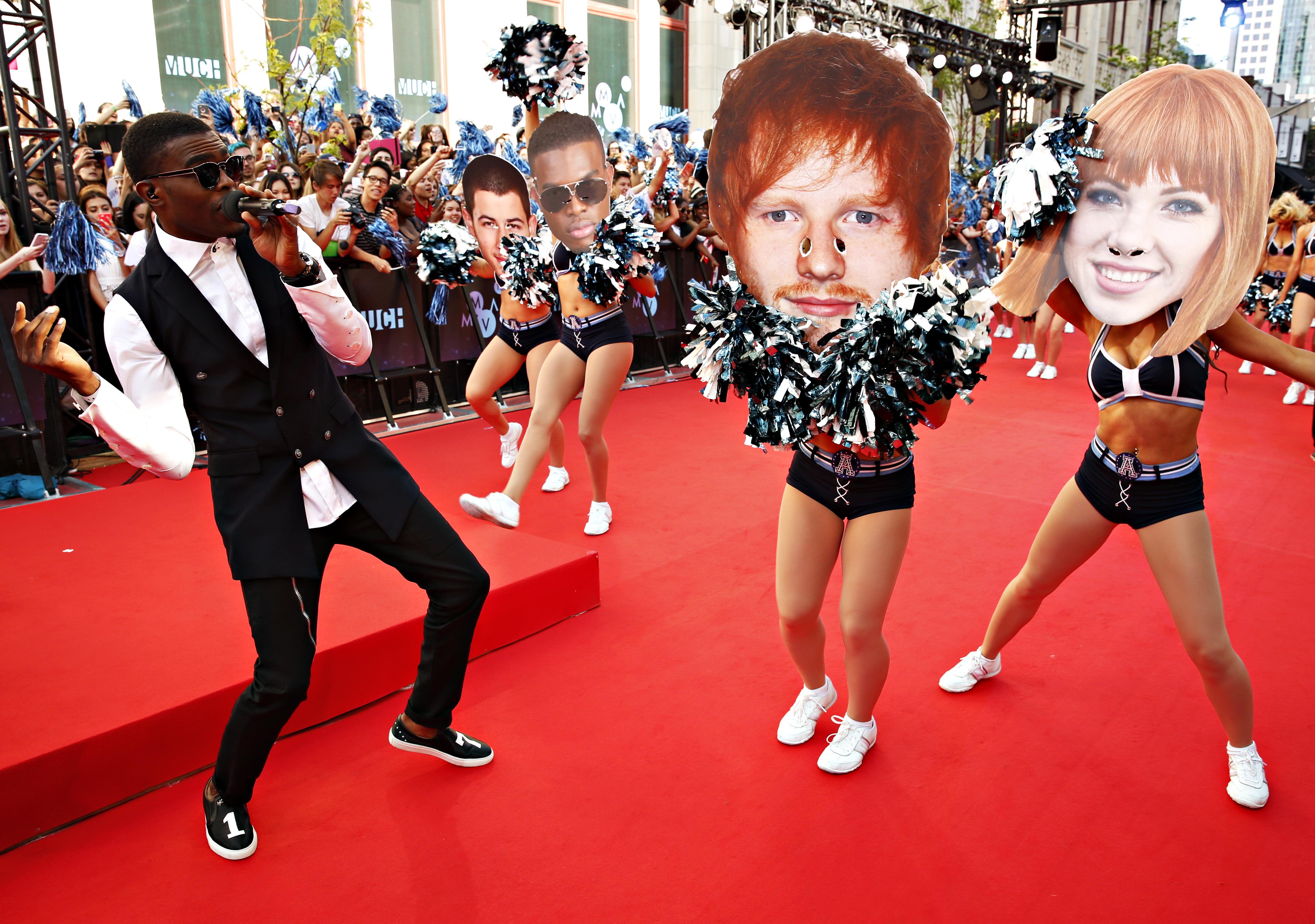 Omi and his cheerleaders